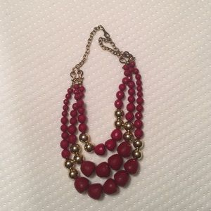 Red and gold three strand necklace