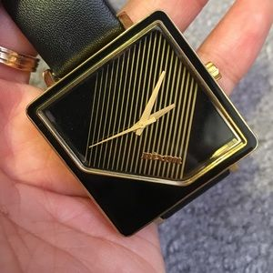 Nixon The Metric Black and Gold watch
