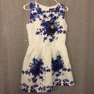 White dress with blue floral print
