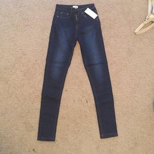 Size 24 dark wash skinny jeans from Tobi