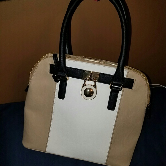 60% off Charming Charlie Handbags - White tan and black purse from ...