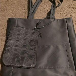 Slate gray tote bag with mini cosmetic bag