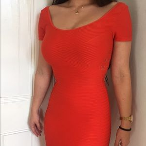 Orange Bebe bandage dress