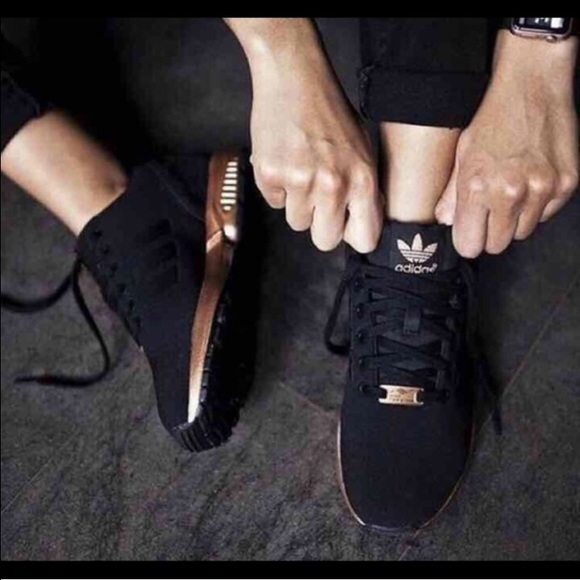 nero and gold adidas flux