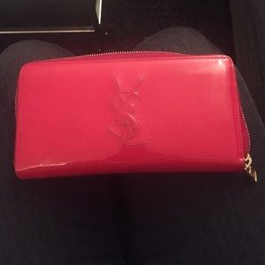 YSL red patent leather zip around wallet.