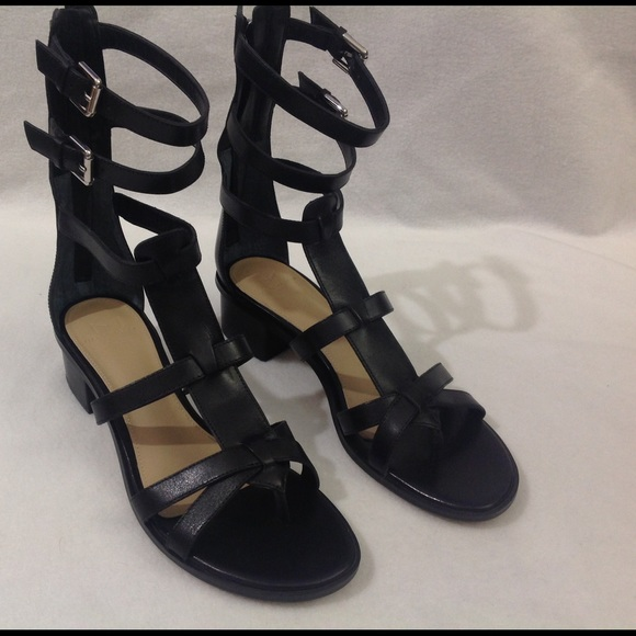 56c3062d824 7.5M Marc Fisher black sandals. Strappy boots