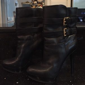 Black leather and shearling platform dress boots.