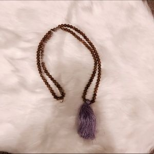 Jewelry - Tan bead and purple silk fringe tassel necklace