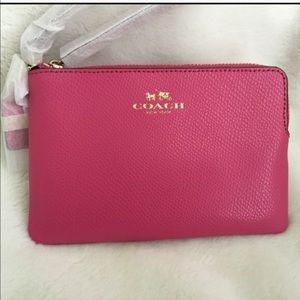Coach Handbags - ❌FIRM❌Coach Pink Leather Corner Zip Wristlet