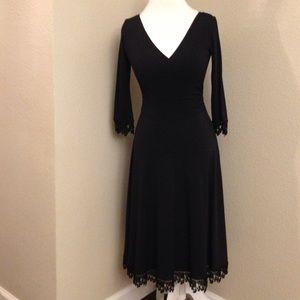 Maggy London Dresses & Skirts - Stunning Black Crochet Detail Dress