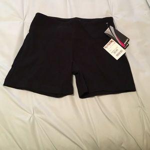 NWT black yoga shorts .