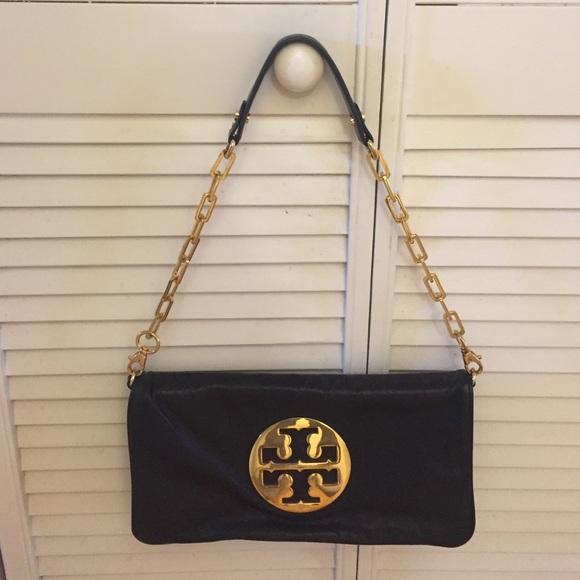 5bd76ed23fae Tory Burch Reva Glazed Black Leather Clutch Bag. M 57fa94ba620ff7ad7c000bf2