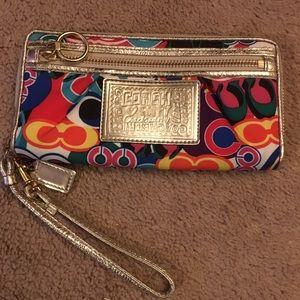 Used Coach Poppy wristlet wallet