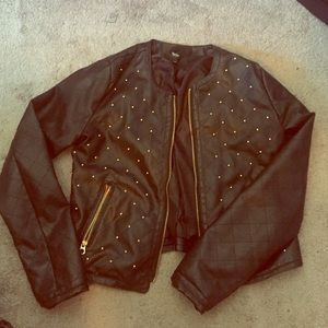 Quilted leather jacket with gold detail.