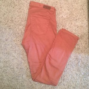 AG burnt orange skinny legging jeans. Size 28.