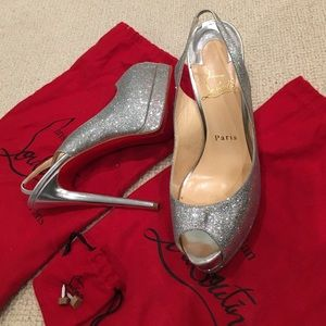 Authentic Christian Louboutin silver pumps