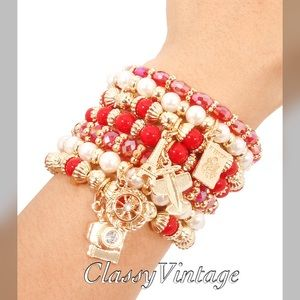 boutique Jewelry - An elegant gathering of Pearl and Ruby bracelets