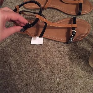 Brown and black strappy sandals