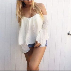 Off shoulder white bell sleeved top
