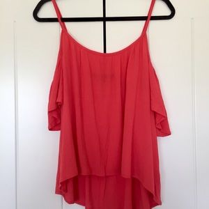 Knit top with cut out shoulder