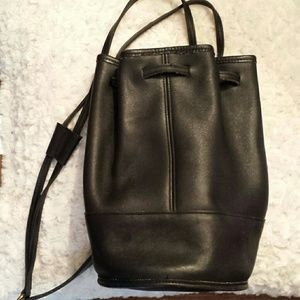 Coach  Handbags - Vintage Coach Bixby Black Leather Sling Backpack