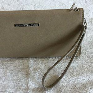 Nina Ricci Handbags - Neutral Nina Ricci Wristlet Clutch