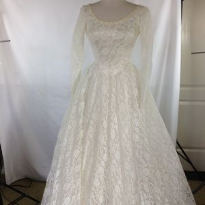 Vintage wedding dress.  Lots of lace size 4