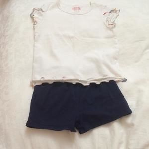 Other - White tee and navy shorts