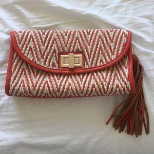 Orange leather woven clutch bag