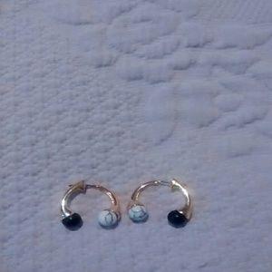 Unique design nOir brand earrings.