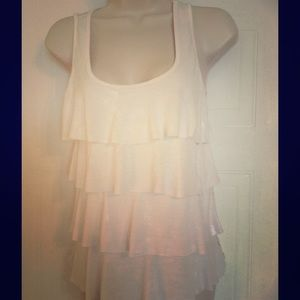 Very cute cream colored top. Back is lacy.