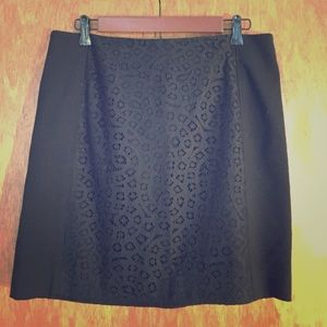 Classic black skirt with detail.