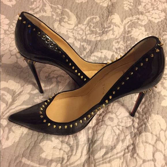 separation shoes 0bc64 18da2 Christian Louboutin Gold Spike Black Pumps