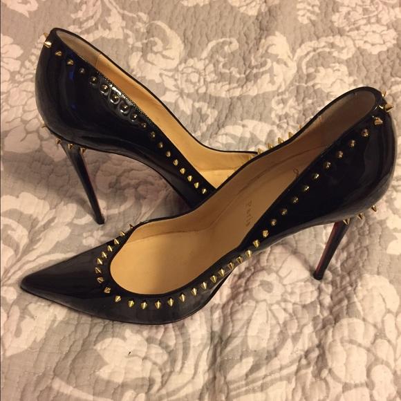 separation shoes 9ce54 6afc6 Christian Louboutin Gold Spike Black Pumps