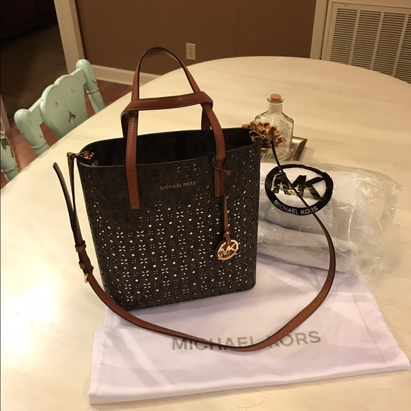 352e8eac6b45 Michael Kors Hayley Gold Perforated Signature tote.  M 5813bb7bfbf6f9774e011ff0