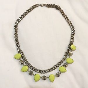 Silver necklace with neon yellow jewels
