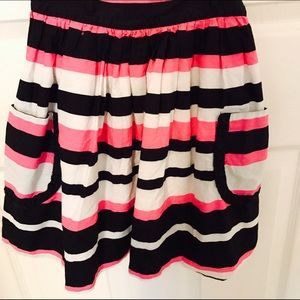 Other - A pink, black, and white skirt with front pockets.
