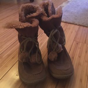 Steve Madden moccasin boots with faux fur lining.