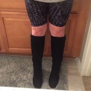 Black up to knee high wedge heel boots