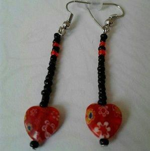 Black, red heart dangling earrings...