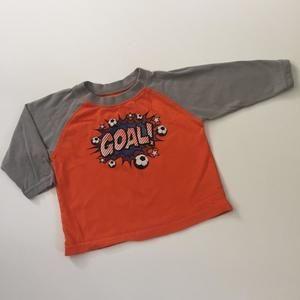 Kids Korner orange  and grey soccer shirt