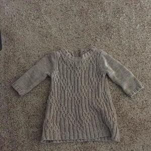 Tan knit sweater. Smoke free home.