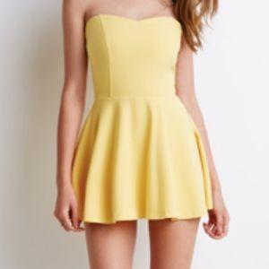 380bf7e85108 Forever 21 Dresses - Yellow strapless skort romper