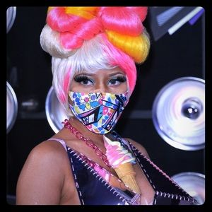 Among the massive heap of colorful crap she was wearing, did you catch Nicki Minaj's swirled ice cream necklace at MTV's VMA Awards? The lick-at-your-own-risk jewelry, from OnchMovement, is.
