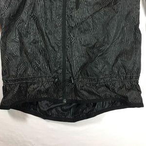 f68202104e Nike Jackets   Coats - Nike zebra print reflective windbreaker jacket
