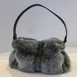 Stylish Faux Fur Accent Bag.