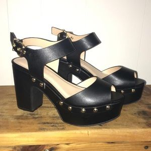 Black heels with gold studs
