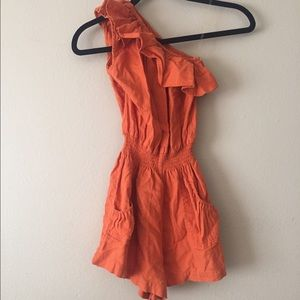 One shoulder ruffled orange romper 