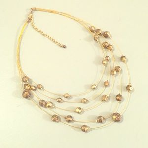 Gold beaded wire statement necklace