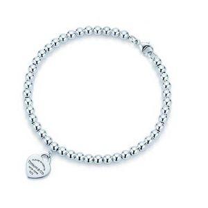Tiffany & Co. mini heart sterling silver bracelet